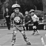 young boy rollerskating in china