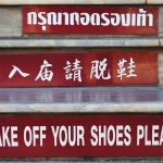 thai chinese english sign at temple