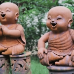 two laughing children statues