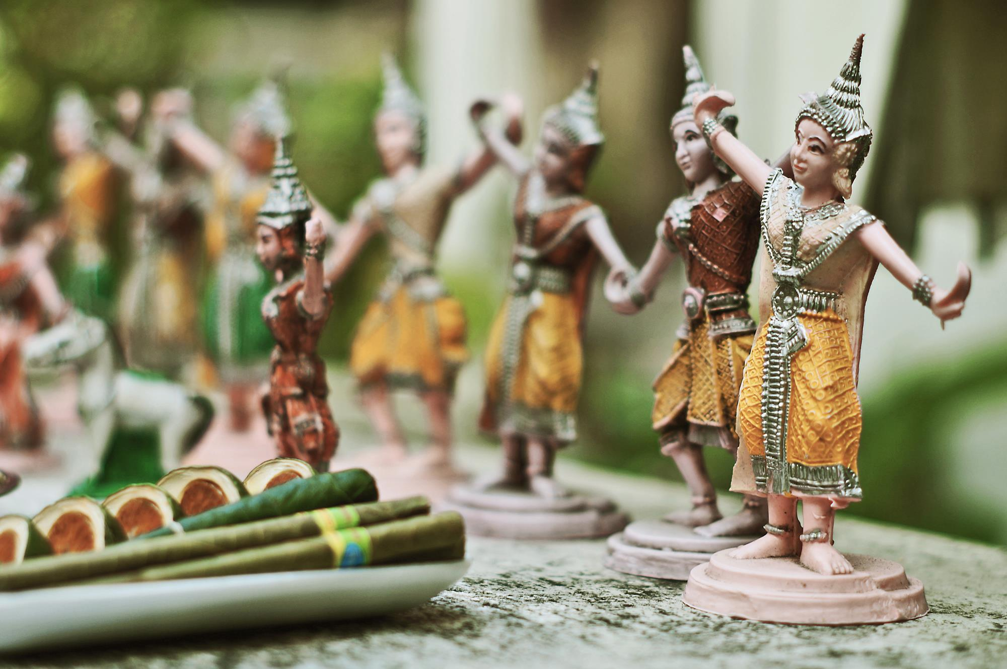 small yellow thai buddhist figurines