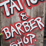 tattoo and barber shop sign