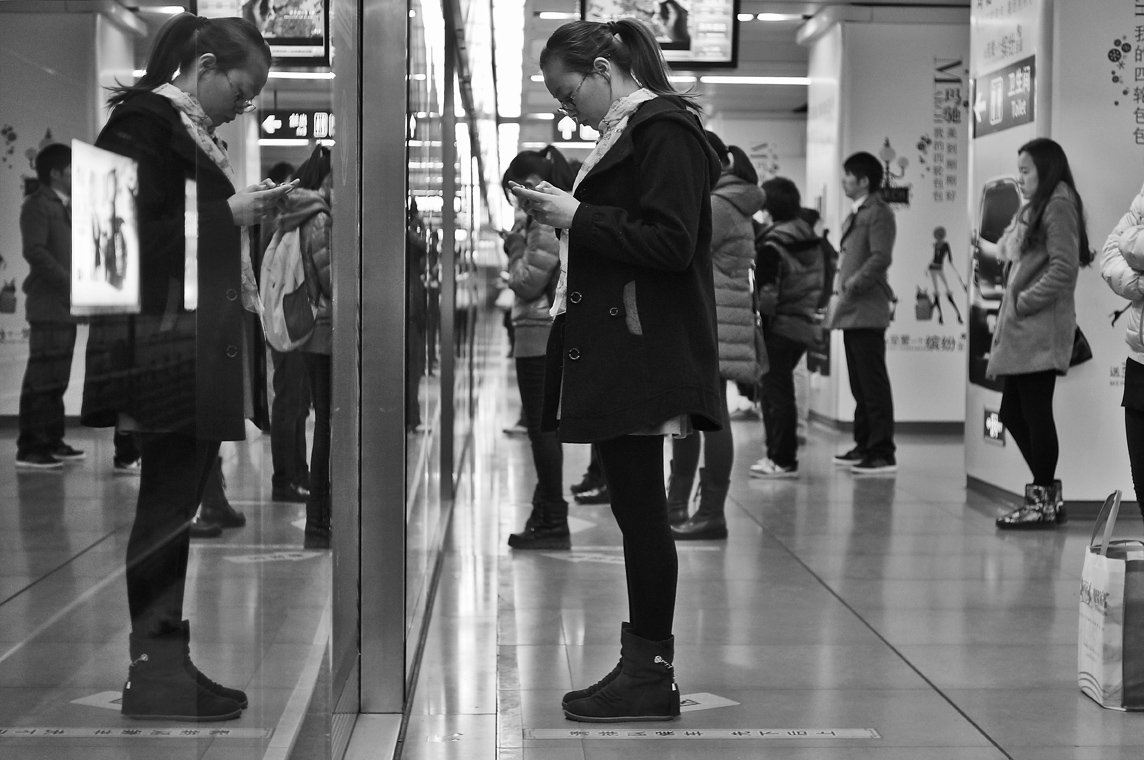 girl in a suzhou subway station