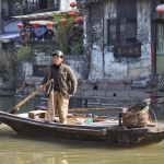 local chinese boat man in xitang