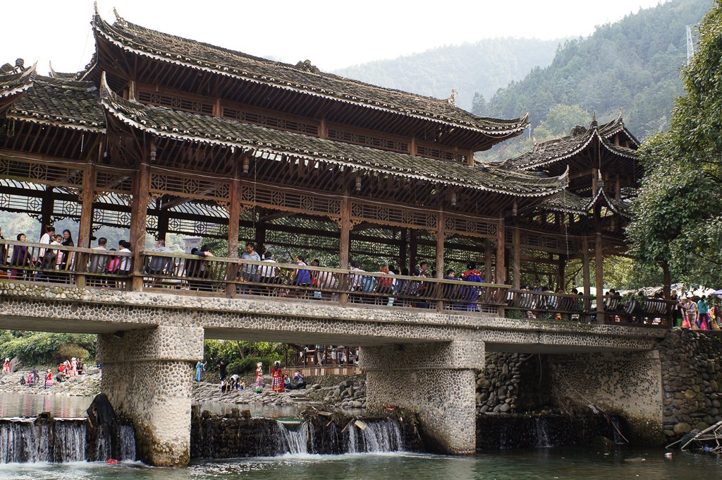 china xijiang miao village bridge