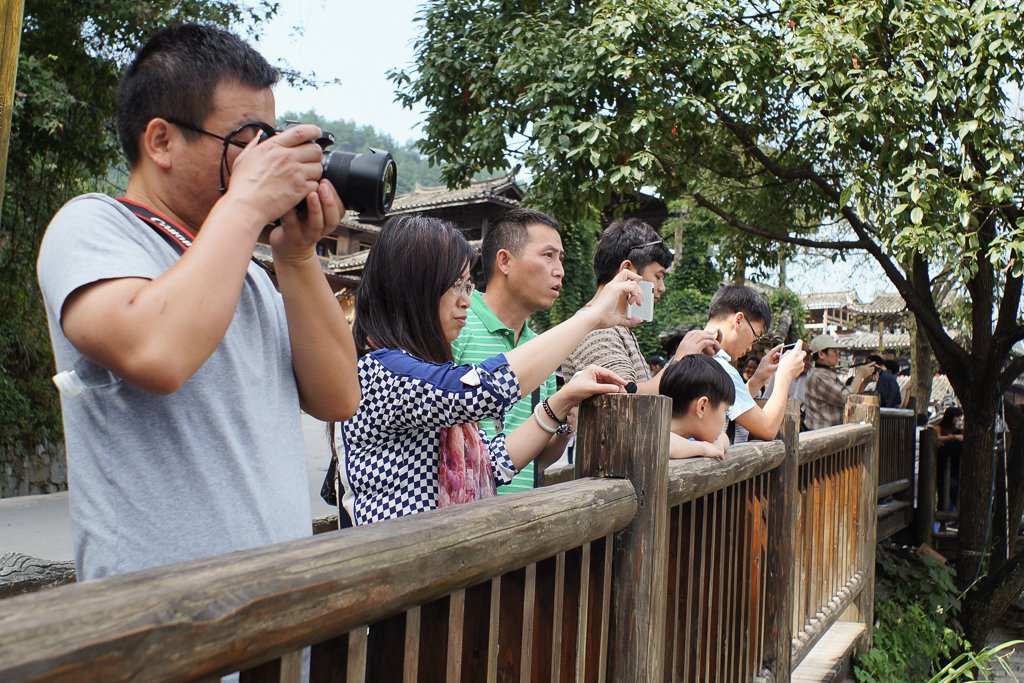 chinese tourists cameras