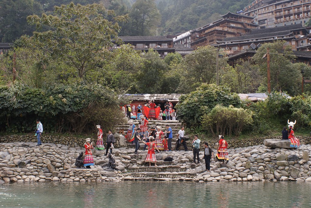 xijiang village river costume tourists