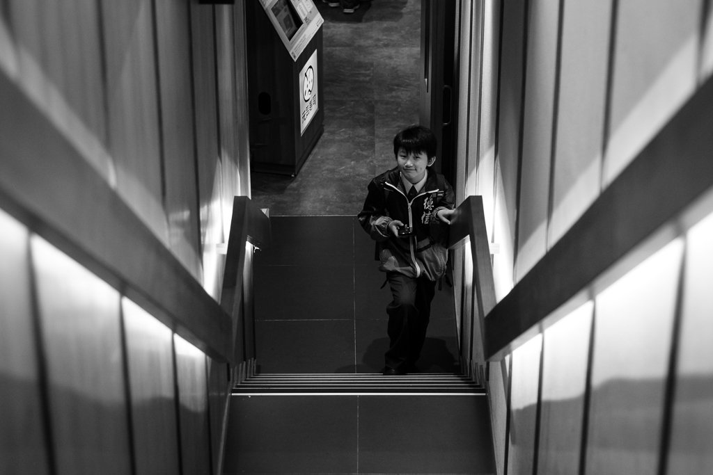 monochrome street photo boy