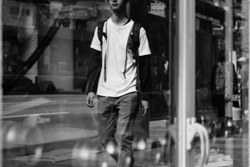 monochrome street photo window reflection