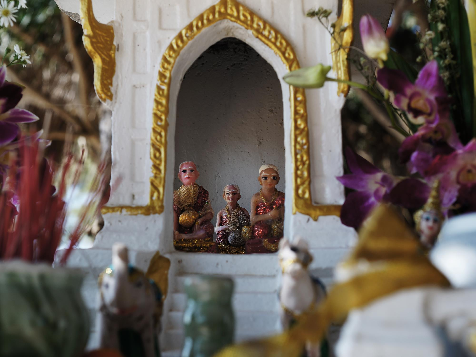 small thai buddhist figurine shrine