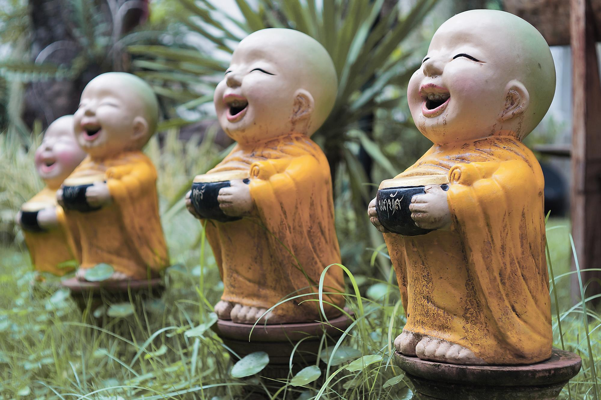 statues of young buddhist monks