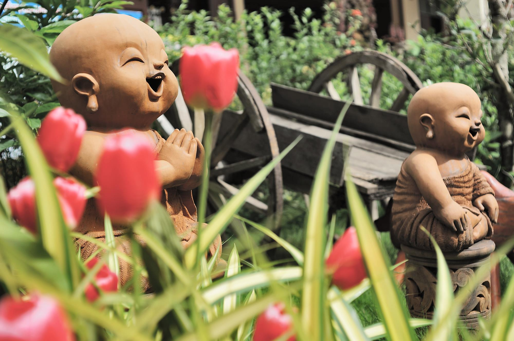buddhist statues in flower garden