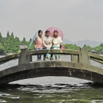 three chinese girls at hangzhou west lake