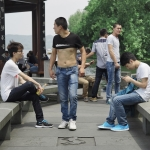 chinese men at hangzhou west lake