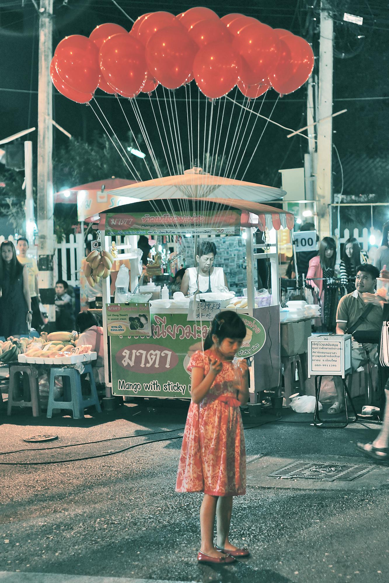 girl in red dress chiang mai night market