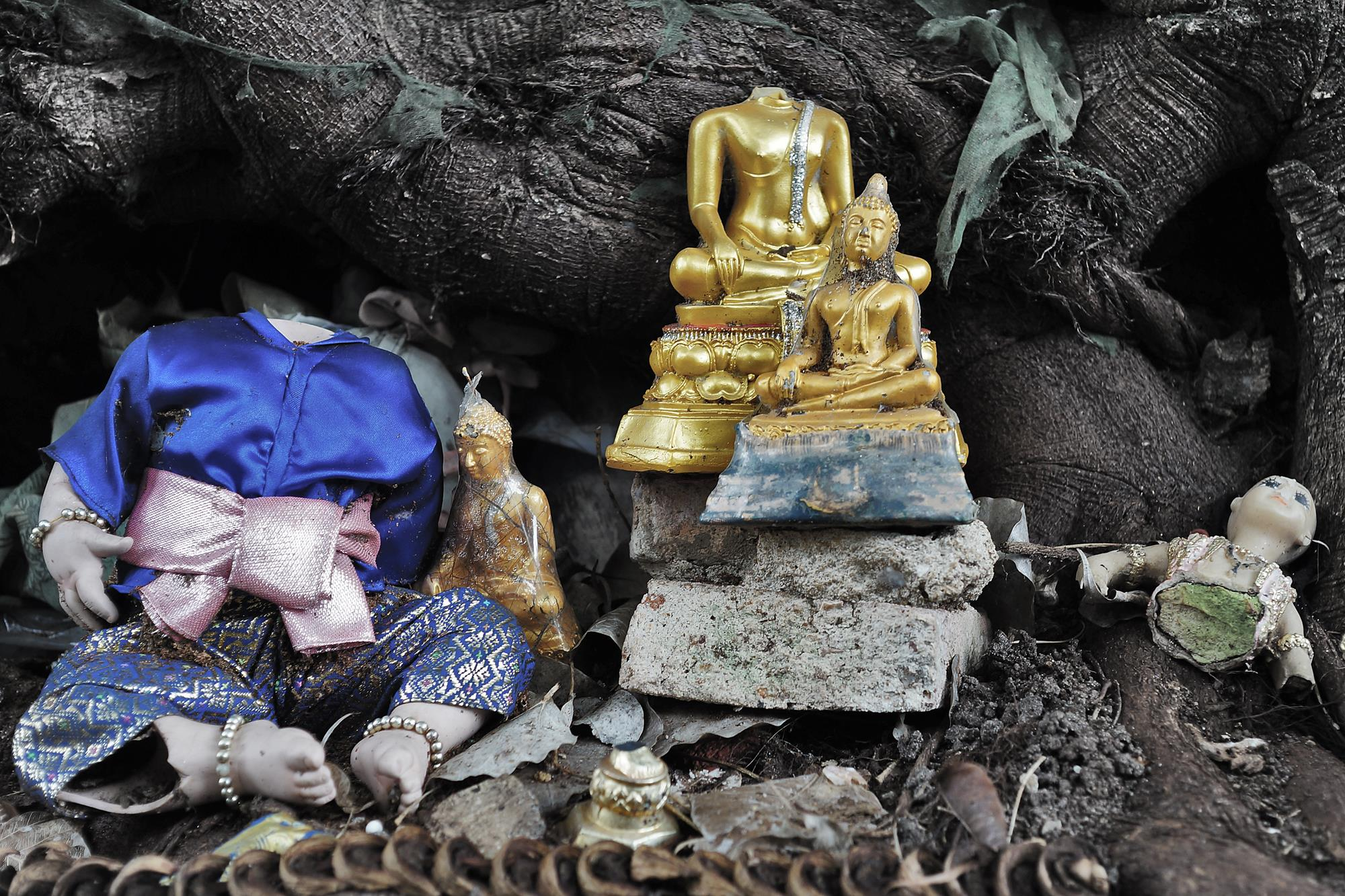 old religious dolls under tree