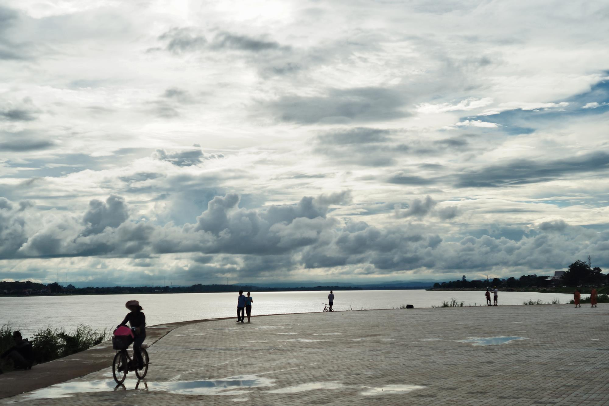 cyclist at vientiane riverside laos