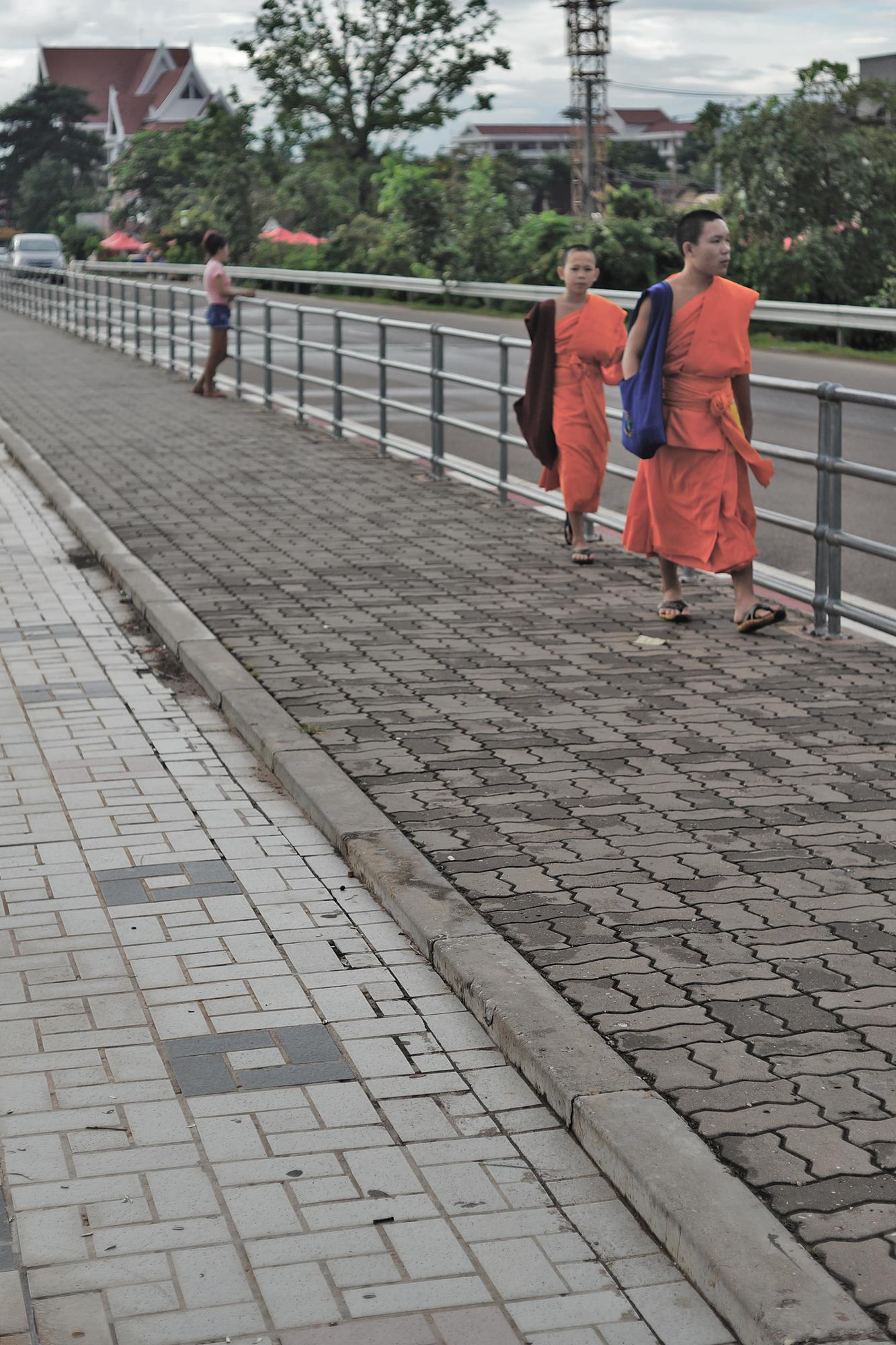 monks at vientiane riverside laos