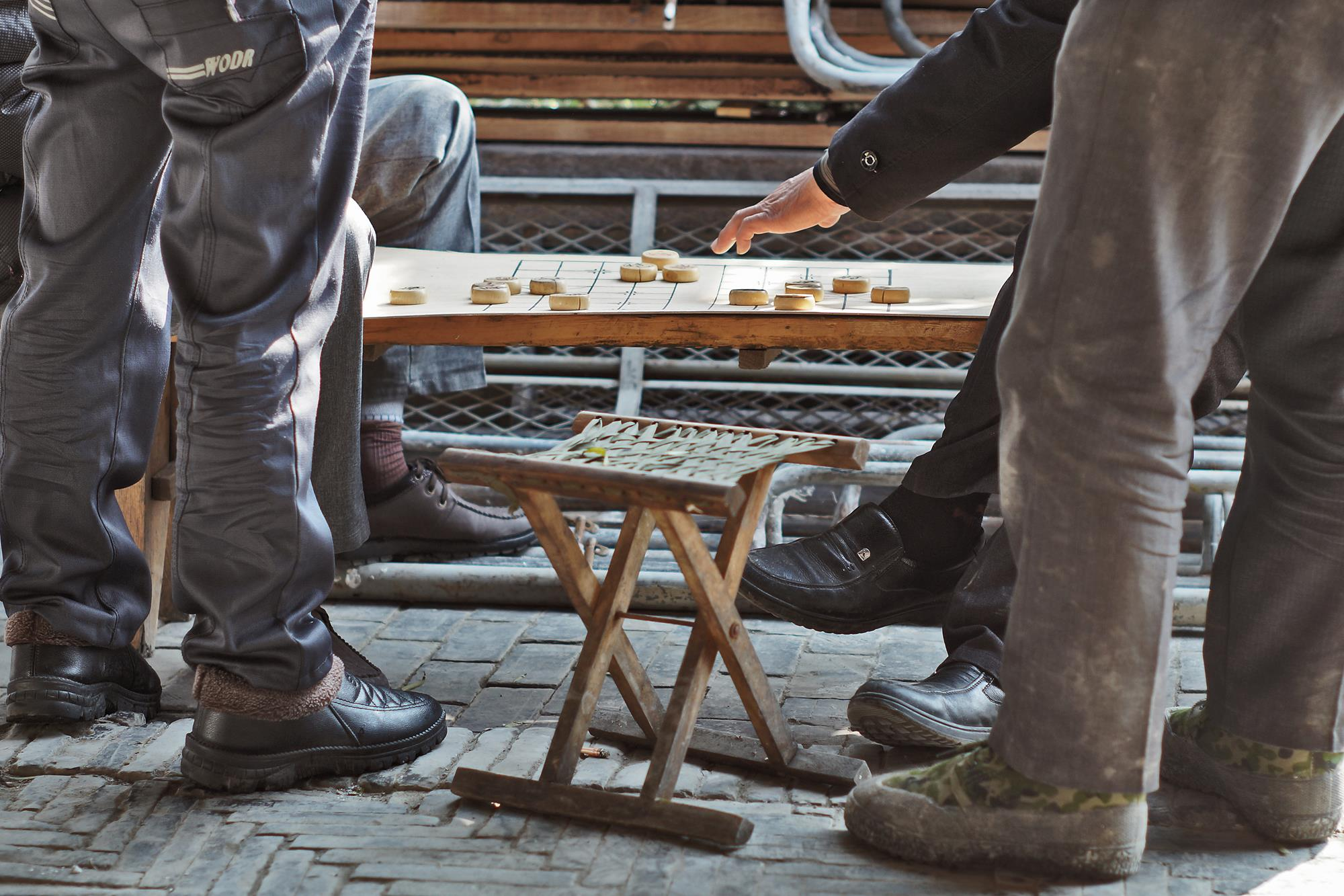 playing chinese chess in the street