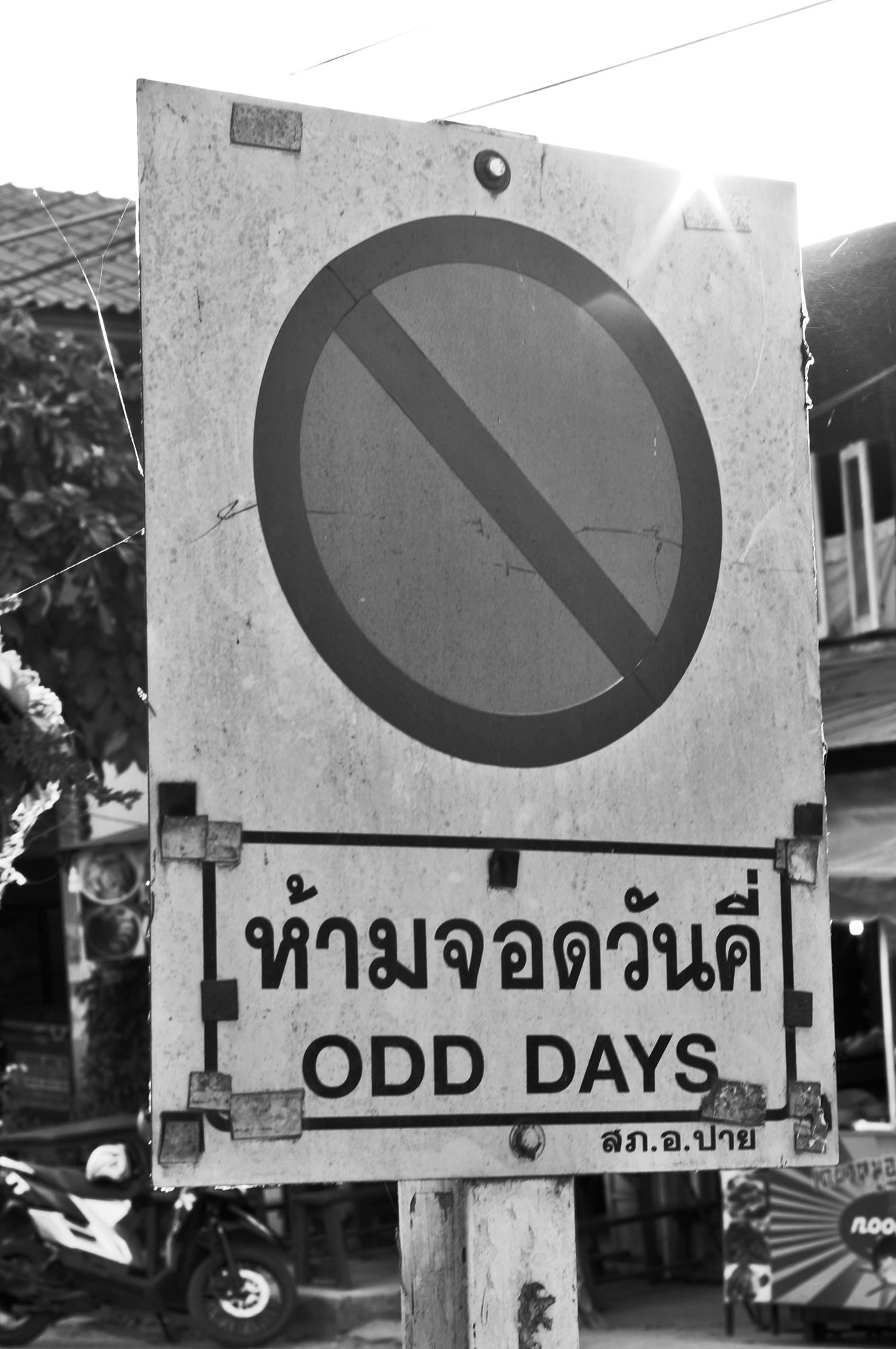 thai road sign odd days